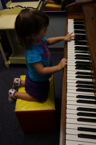 My girl playing piano.